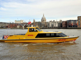 DHL Express riverboat on river with St Pauls